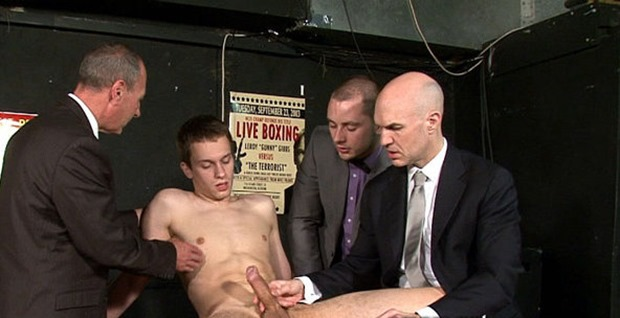 clothed guys stripping a straight guy